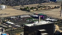 Main stage and artificial grass spectator area of Route 91 in September 2017, partially obscured by Luxor hotel block. Photograph taken from a helicopter during final preparations for the 2017 event.
