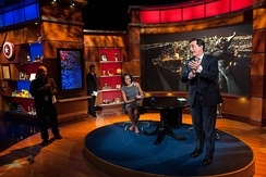 Colbert on the show's set, preparing to interview First Lady Michelle Obama in 2012.