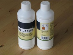 Bottles of alkaline drain cleaners containing lye
