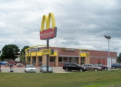 "An American McDonald's in Mount Pleasant, Iowa in June 2008; this is an example of the ""new"" look of American McDonald's restaurants"
