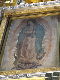 Our Lady of Guadalupe, patron saint of Mexico. This painting of her at the Basilica of Guadalupe is among her most notable depictions; scientists still debate if it should be dated 1531, the year of the first apparition,[407] or the 1550s.[408]