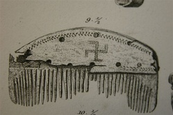A comb with a swastika found in Nydam Mose, Denmark