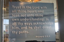Excerpt from Proverbs 3 displayed at Portland International Jetport in Portland, Maine