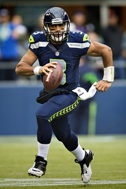 Russell Wilson wearing the current Seahawks home uniform.
