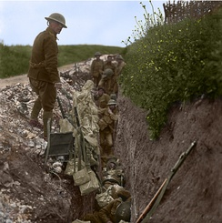 Restored photo of Regiment members in St. John's Road, a support trench, 200 metres behind the British forward line at Beaumont Hamel, 1916