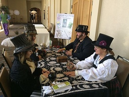 Cosplayers (left) receive steampunk tarot readings at the 2015 Salt City Steamfest in Salt Lake City