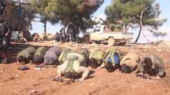 "Free Syrian Army fighters praying after capturing Mount Barsa (""Barṣāyā""). The conservative values of the Turkish-backed FSA fighters caused tensions with many ""leftist-minded"" Kurdish civilians.[11]"