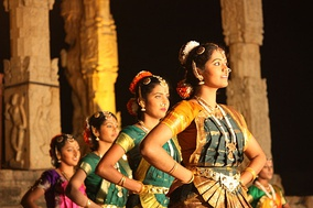 Dancers at Thanjavur, Brihadeshwara temple dedicated to Shiva. The temple has been a major center for Bharatanatyam since about 1000 CE.[15]