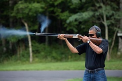 Barack Obama skeet shooting with a Browning Citori 525 on the range at Camp David.