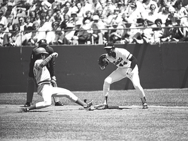 Willie McCovey attempts to tag Cincinnati Reds' shortstop Dave Concepción out at first base in McCovey's final game at Candlestick Park, Copyright 1980 Sheldon Dunn