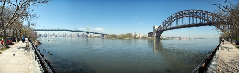 A panorama of the suspension section of the Robert F. Kennedy Bridge (left) and the Hell Gate Bridge (right), as seen from Astoria Park in Queens