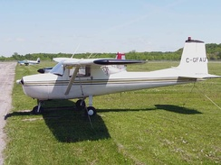 "A 1965 Cessna 150 with ""omni-vision"" rear windows"