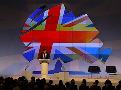 "The Conservatives' ""oak tree"" logo in Union Jack colours at the 2011 party conference."