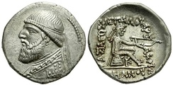 "Coin of Mithridates II of Parthia. The clothing is Parthian, while the style is Hellenistic (sitting on an omphalos). The Greek inscription reads ""King Arsaces, the philhellene"""