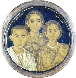 A gold glass portrait of a family from Roman Egypt. The Greek inscription on the medallion may indicate either the name of the artist or the pater familias who is absent in the portrait.[158]