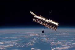 Extrasolar planetary research using the Hubble Space Telescope