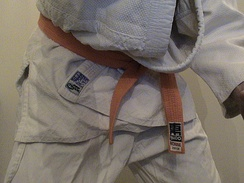 The judogi is made from a heavy weave to withstand the stress of throwing and grappling.