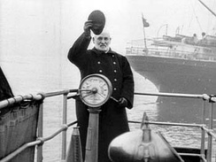 A captain waves aboard a Cunard Line vessel in this picture taken in 1901.