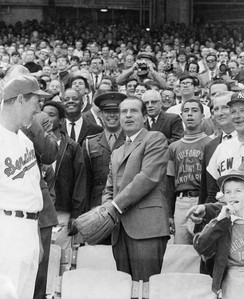 President Richard Nixon throwing out the first ball of the Senators' season in April 1969 with manager Ted Williams (left) and owner Bob Short (right, partially obscured by Yankees manager Ralph Houk).