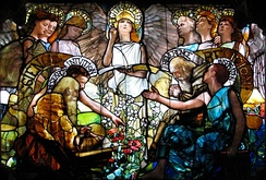 Science and Religion are portrayed to be in harmony in the Tiffany window Education (1890).