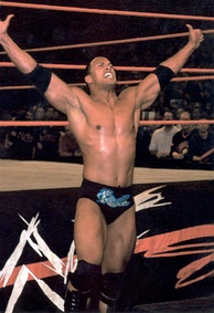 The Rock taunting an opponent at ringside