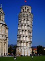 The Flag of Pisa (Pisan cross) flying on the Leaning Tower of Pisa (build 12th-14th century)