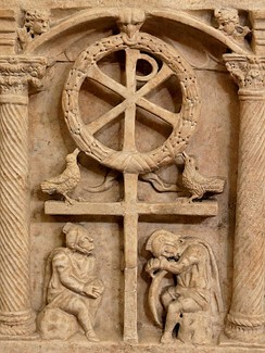 The Chi Rho with a wreath symbolizing the victory of the Resurrection, above Roman soldiers, c. 350 AD.