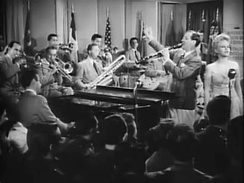 Goodman with his band and singer, Peggy Lee, in the film Stage Door Canteen (1943)