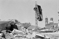 Quneitra village after Israeli shelling, showing a church and an elevated car
