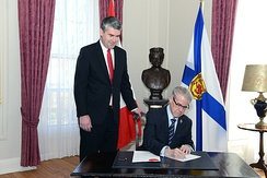 Lieutenant Governor of Nova Scotia, Brigadier-General the Honourable J.J. Grant, signing the Order in Council dissolving the Provincial House of Assembly and calling a provincial general election, 30 April 2017.