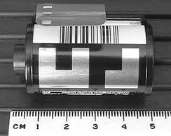 135 Film Cartridge with DX barcode (top) and DX CAS code on the black and white grid below the barcode. The CAS code shows the ISO, number of exposures, exposure latitude (+3/−1 for print film).