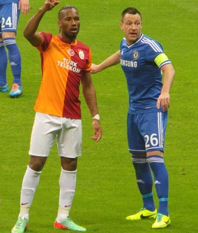 Centre-back John Terry (26, blue) closely marks centre-forward Didier Drogba