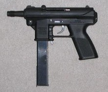 An Intratec TEC-DC9 with a 32-round magazine. This semi-automatic pistol has a threaded barrel and a magazine that attaches outside the pistol grip, two of the features listed in the Federal Assault Weapons Ban.