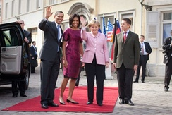 Rathaus in Baden-Baden, Germany, 2009: Barack Obama (the first African American president of the United States), and his wife are welcomed by Angela Merkel (the first woman Chancellor of Germany) and her husband.