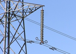 Modular suspension insulators are used for high-voltage lines. The objects attached to the conductors near the bottom of the insulator are Stockbridge dampers.
