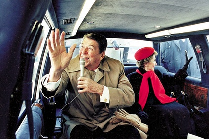 On the campaign trail, President Reagan and First Lady Nancy Reagan wave from limousine while touring Dixon, Illinois. February, 1984.
