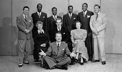 "Photo of 1948 Raleigh Cigarettes Program cast: Standing: Pat McGeehan, The Four Knights, David Rose (orchestra leader). Seated:Verna Felton (""Grandma"" to Skelton's ""Junior"" character), Rod O'Connor (announcer), Lurene Tuttle (""Mother"" to Skelton's ""Junior"" character). Front: Red Skelton."