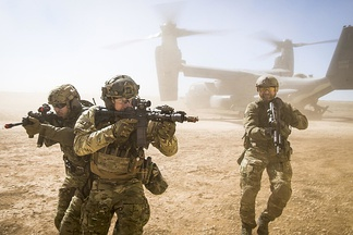 An American special forces team moves together out of an U.S. Air Force CV-22 Osprey aircraft on February 26, 2018.