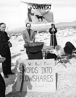 Members of Nevada Desert Experience hold a prayer vigil during the Easter period of 1982 at the entrance to the Nevada Test Site.