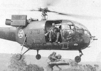 Portuguese paratroopers jump from an Alouette III helicopter in an air-mobile assault in Angola, in the early stages of the Overseas Wars.