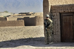 Australian Army Pvt. Brent Rothwell patrols in Tarin Kowt with an HK417, Uruzgan province, Afghanistan, July 26, 2013.