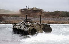 BTR-80s coming ashore, engine snorkels and waterjet deployed