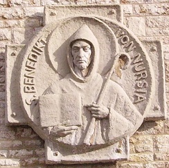 Carving of Saint Benedict of Nursia, holding an abbot's crozier and his Rule for Monasteries (Münsterschwarzach, Germany)
