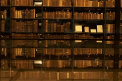 Bookshelf at the Beinecke Rare Book & Manuscript Library. The top floor contains 180,000 volumes. Since 1977, all new acquisitions are frozen at −33 degrees to prevent the spread of insects and diseases.