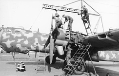 "An He 177 undergoing engine maintenance or overhaul - note the second cylinder's exposed exhaust stub being even with the leading edge, an indication of the rearwards location of the ""power systems""."