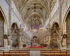 View from the nave of the chancel of Condom Cathedral in France, with ambulatories and two altars, the modern one in the choir
