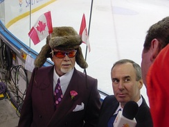 MacLean (right) with Don Cherry at the 2002 Winter Olympics in Salt Lake City, Utah