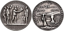 "Commemorative medal issued in 1929 in the Republic of Weimar on the occasion of the 10th anniversary of the ""shameful"" Treaty of Versailles. Designed by Karl Goetz, the obverse of the coin depicts George Clemenceau presenting a bound treaty, decorated with skull and crossbones to Ulrich von Brockdorff-Rantzau. Other members of the Conference are standing behind Clemenceau, including Lloyd-George, Wilson and Orlando."