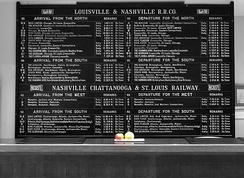 A train schedule informs travelers of the trains going to various locations, and indicates the times of departure.