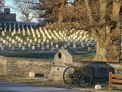 The Lincoln Address Memorial (top left) in the Gettysburg National Cemetery.  The 2 small flanking markers for the 3rd NY Artillery monument (foreground) indicate the breadth of the unit's position.